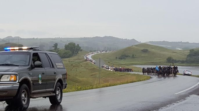 A prayer procession makes it way up Highway 1806.